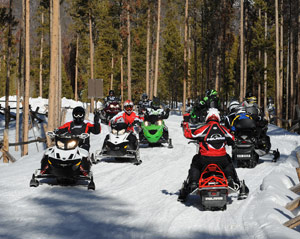 Snowmobilers practicing during a snowmobile safety class