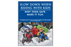 Vertical Poster of Snowmobilers and text 'Slow Down When Riding With Kids. Keep Them Safe. Make it Fun.'