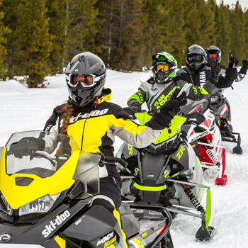 snowmobilers signaling on trail