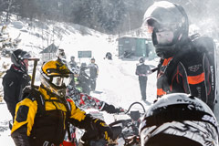 Snowmobilers stopped along trail